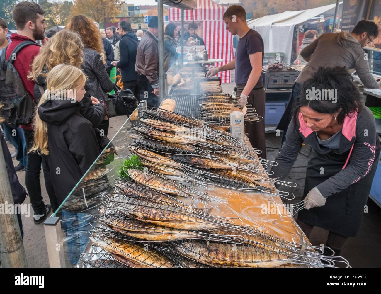 Fresh cooked fish food stall, Mauerpark Sunday fleamarket, Prenzlauer Berg, Berlin, Germany Stock Photo