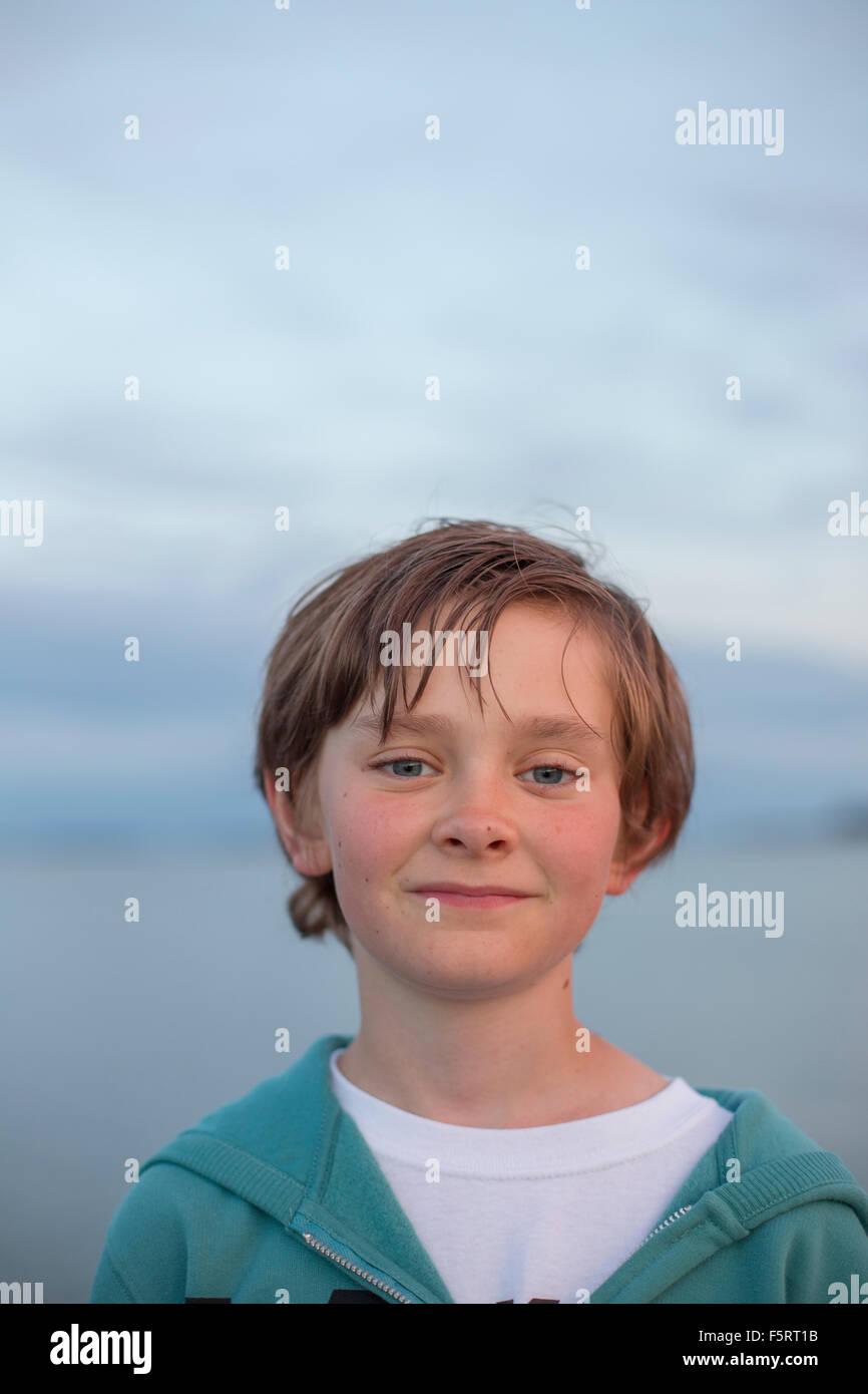 Sweden, Halland, Onsala, Portrait of boy (12-13) outdoors at dusk - Stock Image