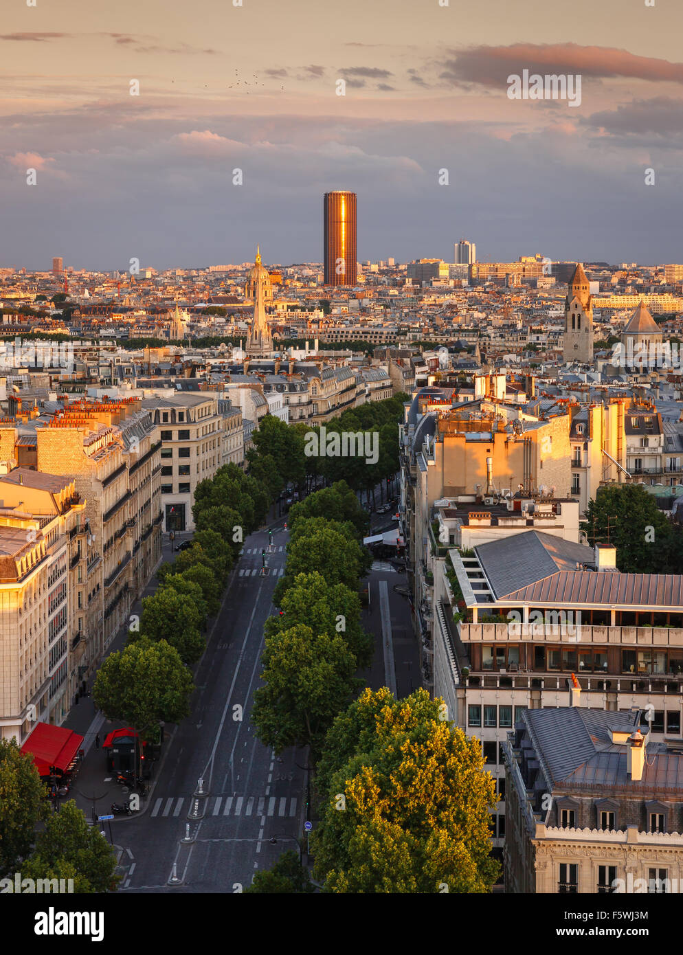 Sunset light on Montparnasse Tower and Avenue Marceau rooftops in the 16th arrondissement, Paris, France - Stock Image