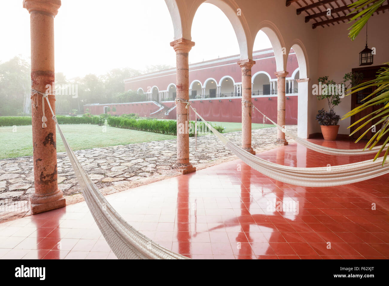 Hammocks Line The Patio On A Misty Morning At The Temozon Hacienda In  Yucatan, Mexico.