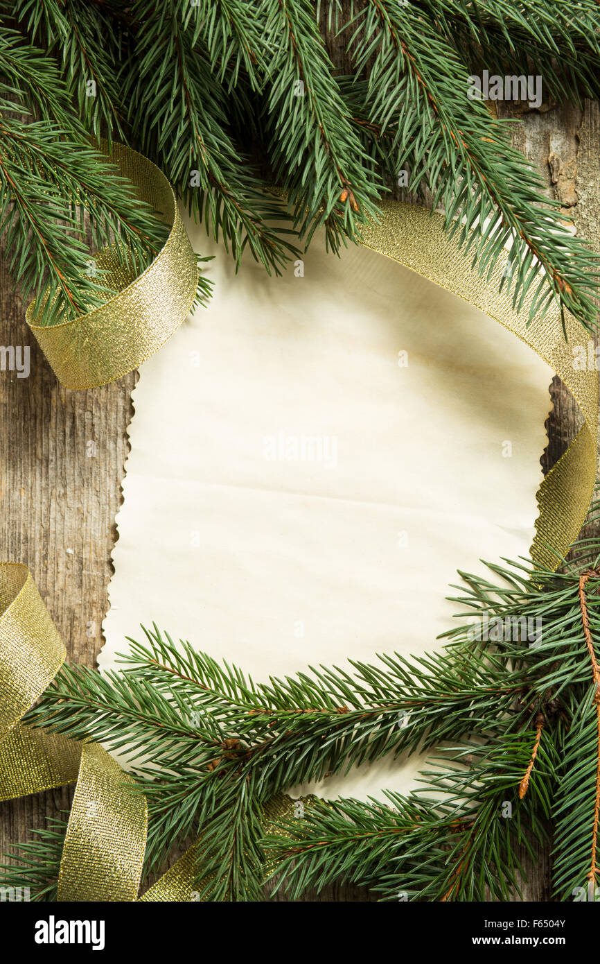 christmas tree branches with blank paper card and golden ribbon on wooden background top view image of christmas decoration - Blank Christmas Tree