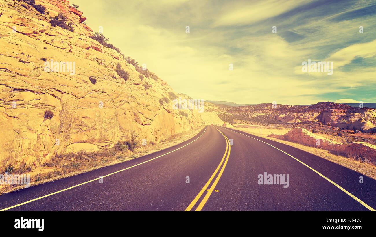 Vintage toned empty road, travel concept picture. - Stock Image