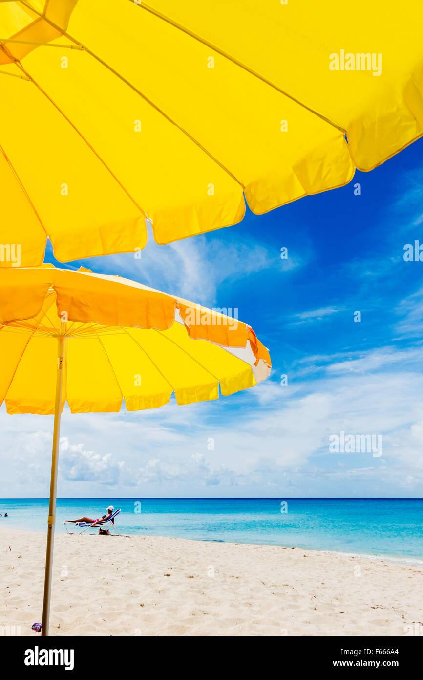 bright-yellow-beach-umbrellas-against-a-