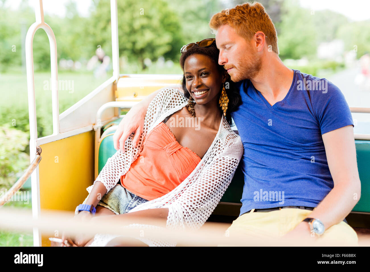 Couple in love traveling by a scenic railway and being happy outdoors - Stock Image