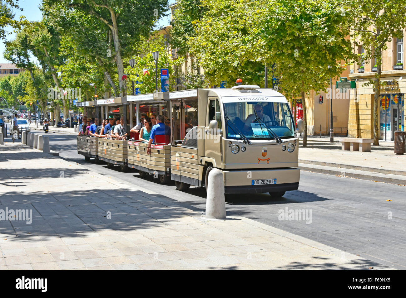 Aix-en-Provence South of France Land train sightseeing trip along the prestigious Cours Mirabeau boulevard on a - Stock Image