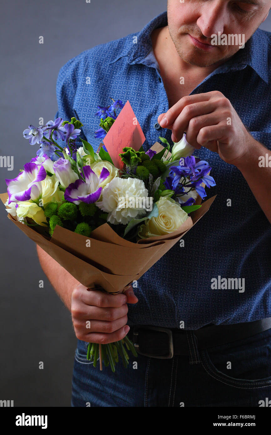 Man holding a bouquet of flowers a man makes a proposal to a woman man holding a bouquet of flowers a man makes a proposal to a woman a lover of flowers and a ring love note hidden in the flowers note mistress izmirmasajfo