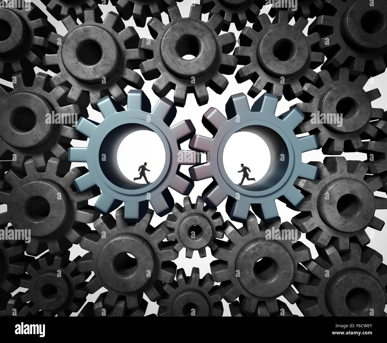 Industry partnership business planning concept as a team of businesspeople running inside a gear or cog wheel working - Stock Image