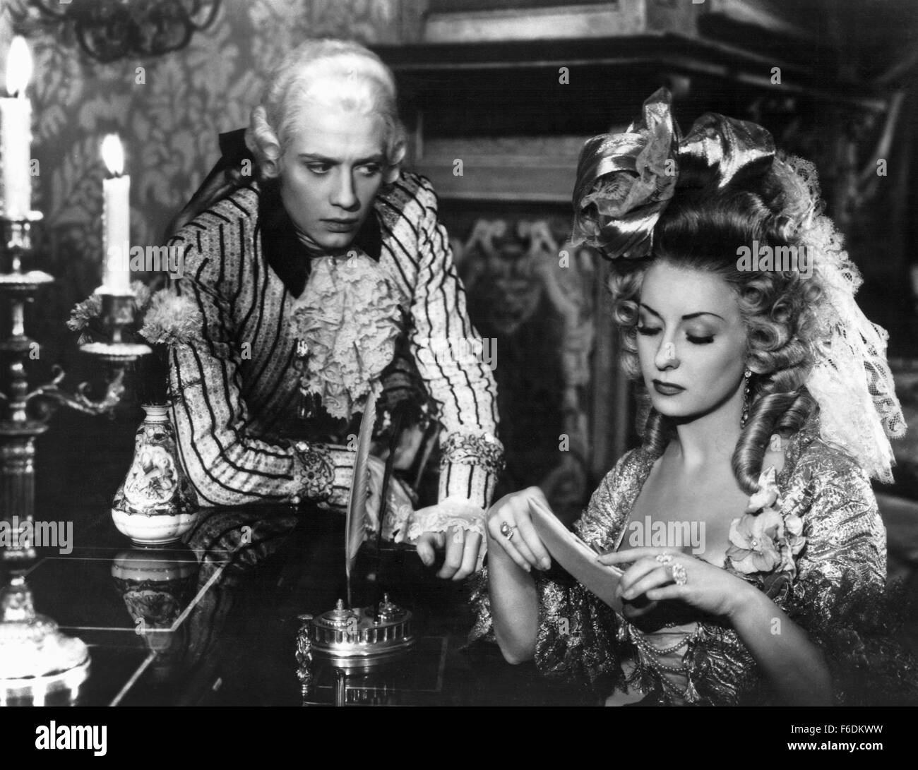 Jan. 1, 1940 - Jacques Dacqmine and Viviane Romance on-set of the Film, The Queen's Necklace, (aka L'Affaire - Stock Image