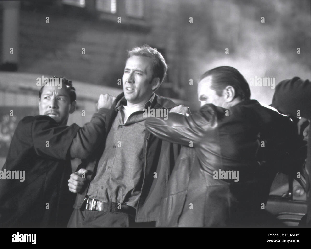 Jul 23, 2002; Hollywood, CA, USA; Actor NICOLAS CAGES (C) as Randall 'Memphis' Raines in the movie 'Gone in 60 Seconds.'. Stock Photo