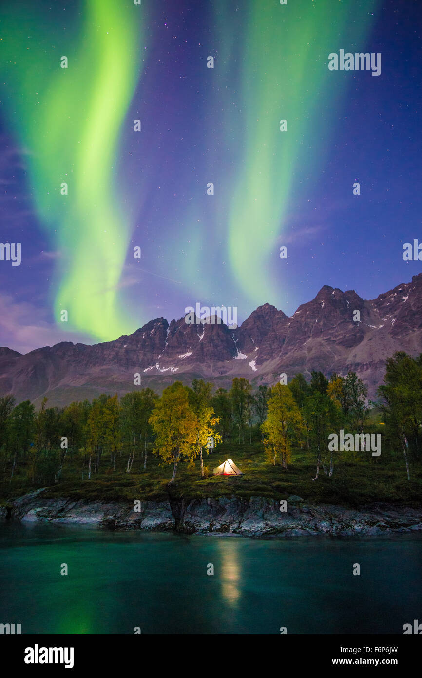 Camping under the Northern Lights - Stock Image