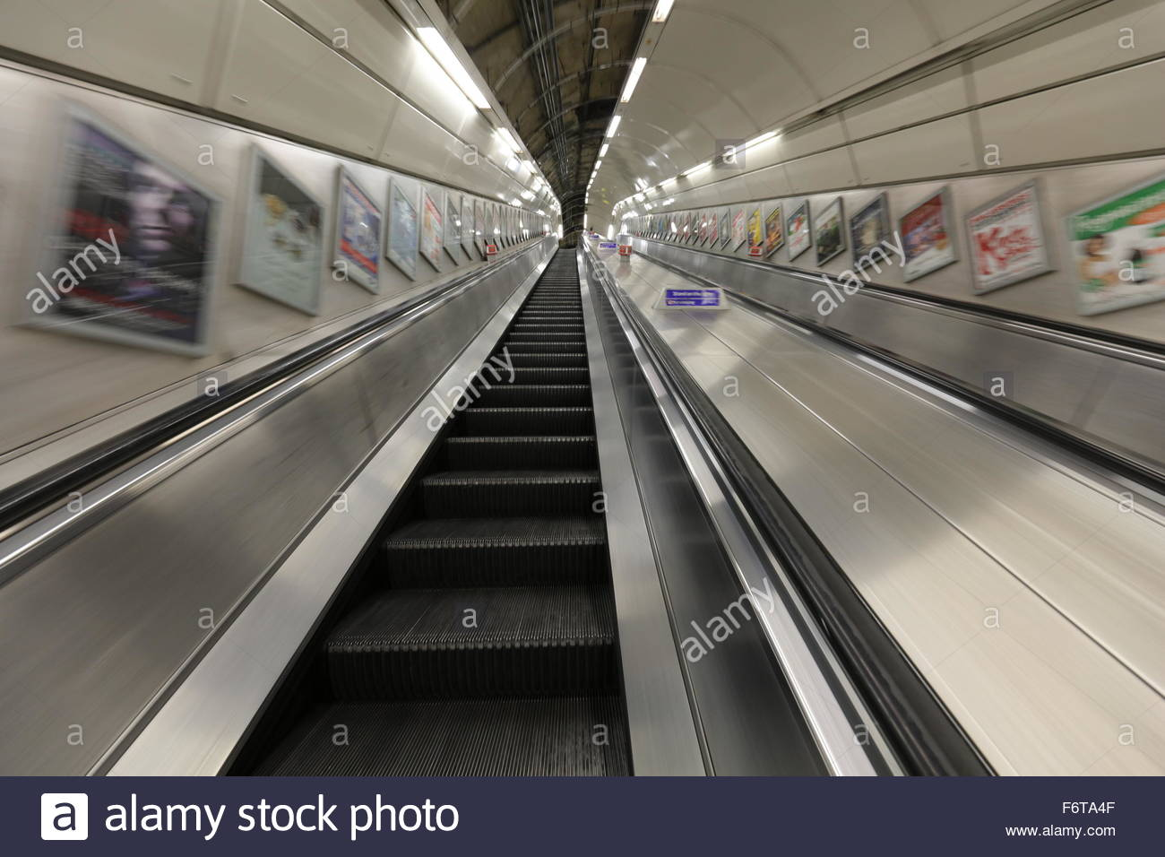 moving-stairs-walls-and-advertisement-motion-blurred-F6TA4F.jpg