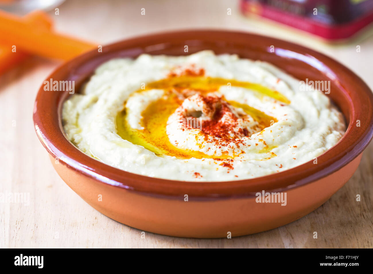 Homemade Hummus by some carrot sticks - Stock Image