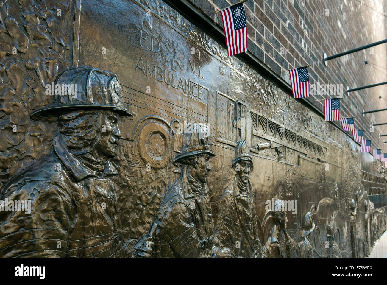 Bronze wall mural dedicated to the fallen firefighters of September 11, World Trade Center, Lower Manhattan, New - Stock Image