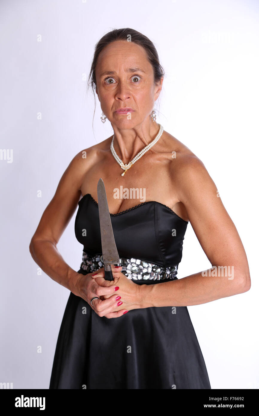 mad mature woman with a big knife / meat cleaver stock photo