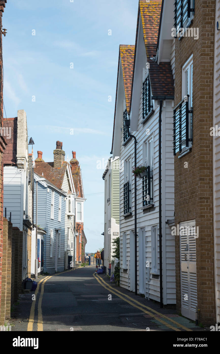 Sea Wall street with wooden houses, Whitstable Harbour, Whitstable, Kent, England, United Kingdom - Stock Image