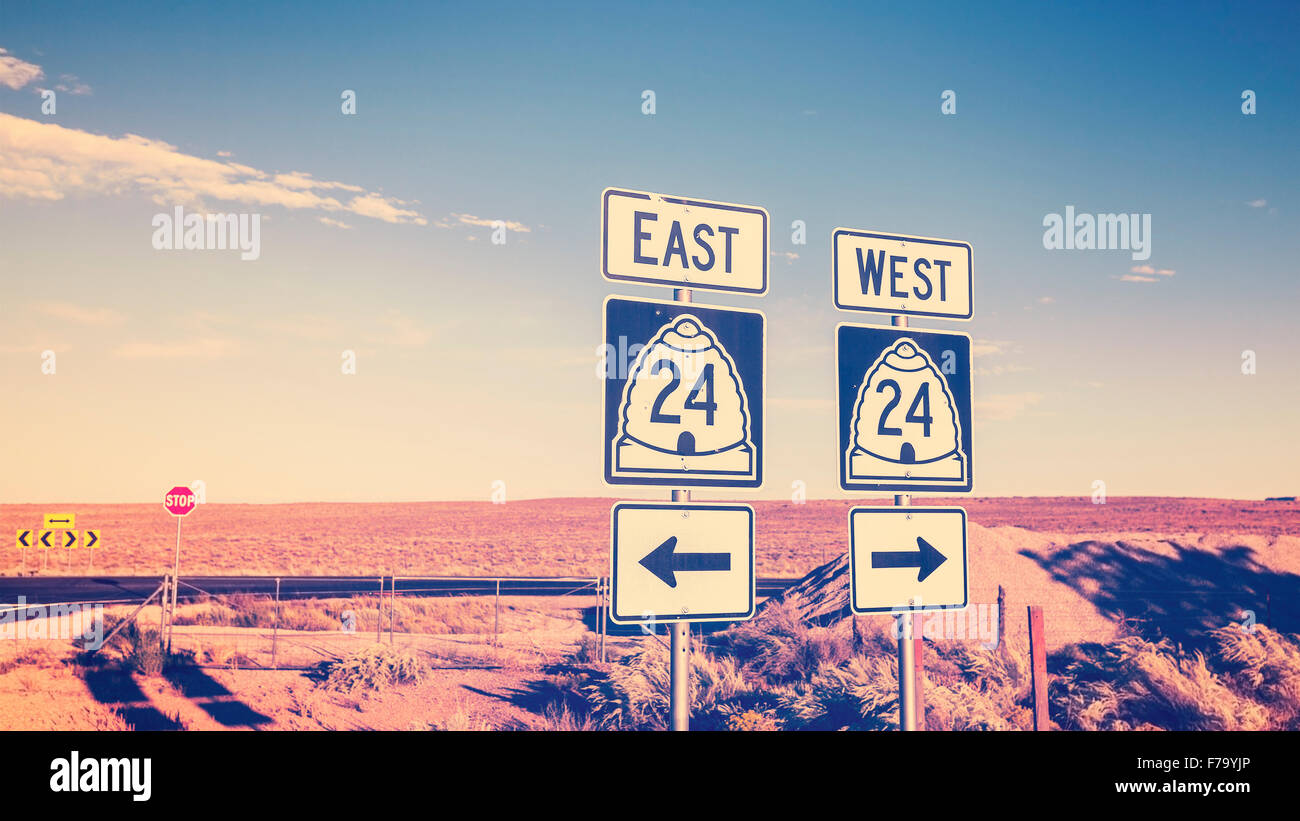 Vintage cross processed photo of road signs, choice concept. - Stock Image