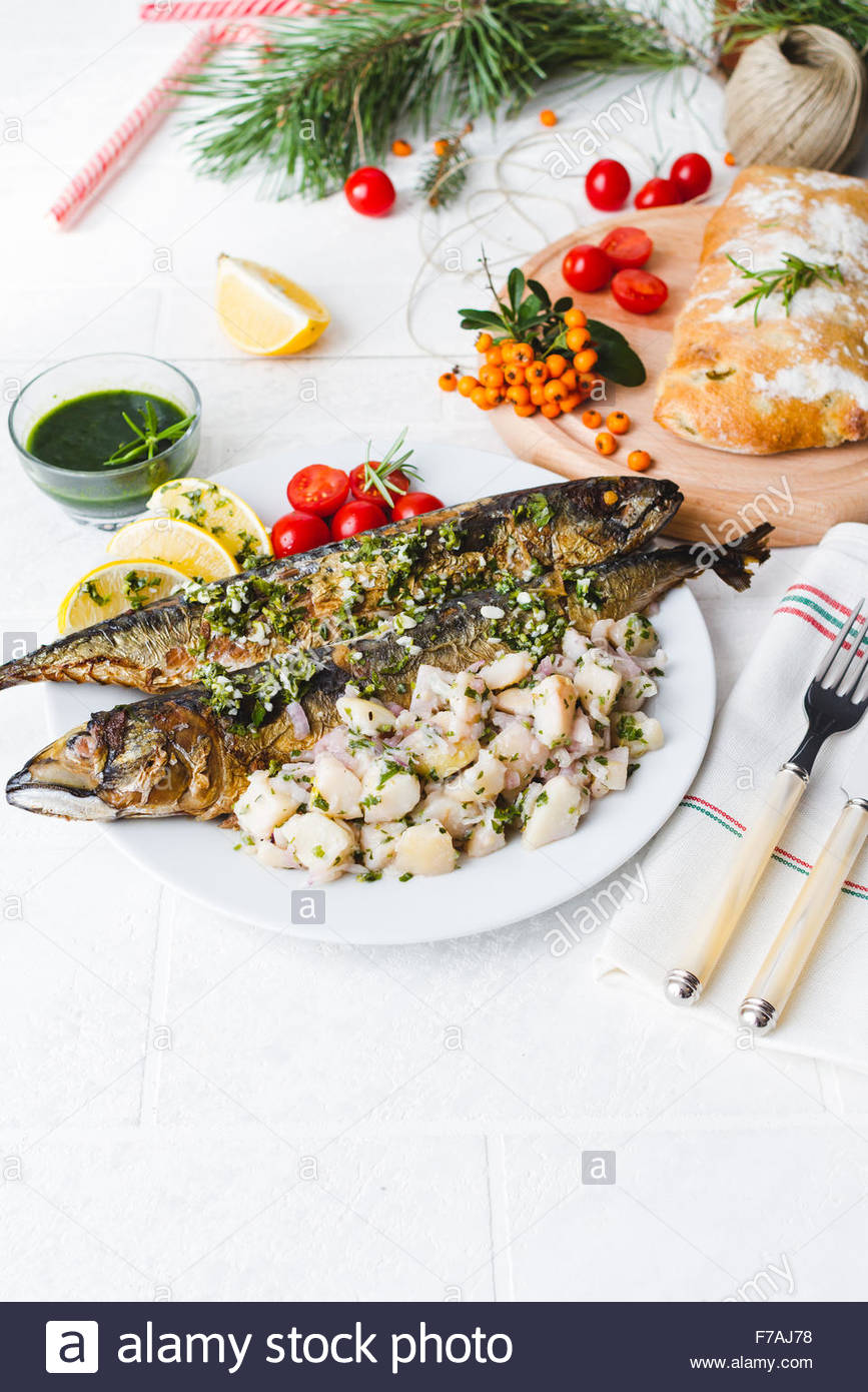 Plate of fresh roasted whole mackerel fish. Christmas Eve Dinner ...