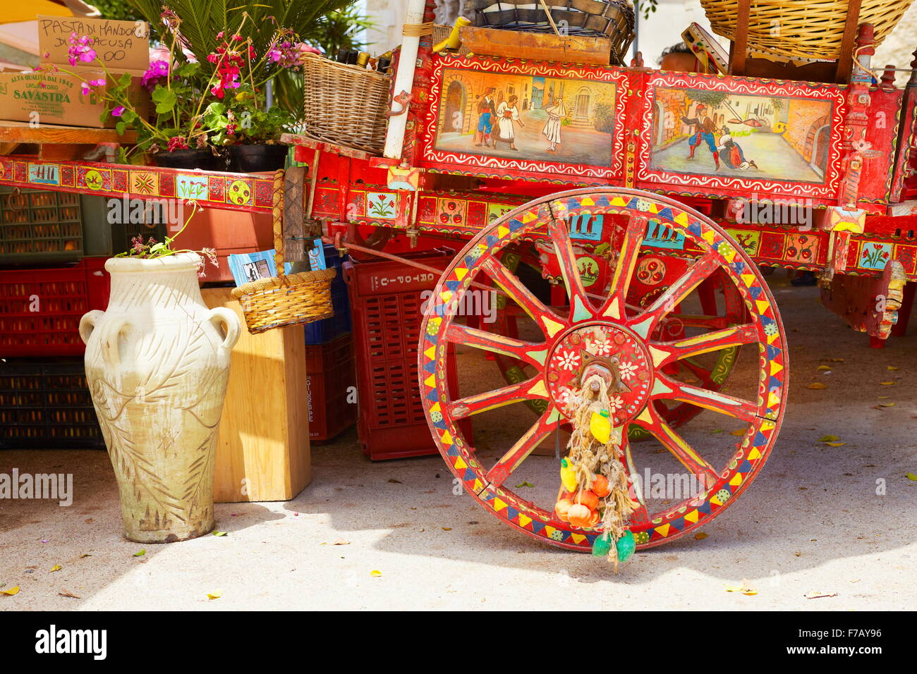 Colorful decorated cart, traditional Sicilian rural horse-drawn carriage, street decoration, Sicily Island, Italy - Stock Image