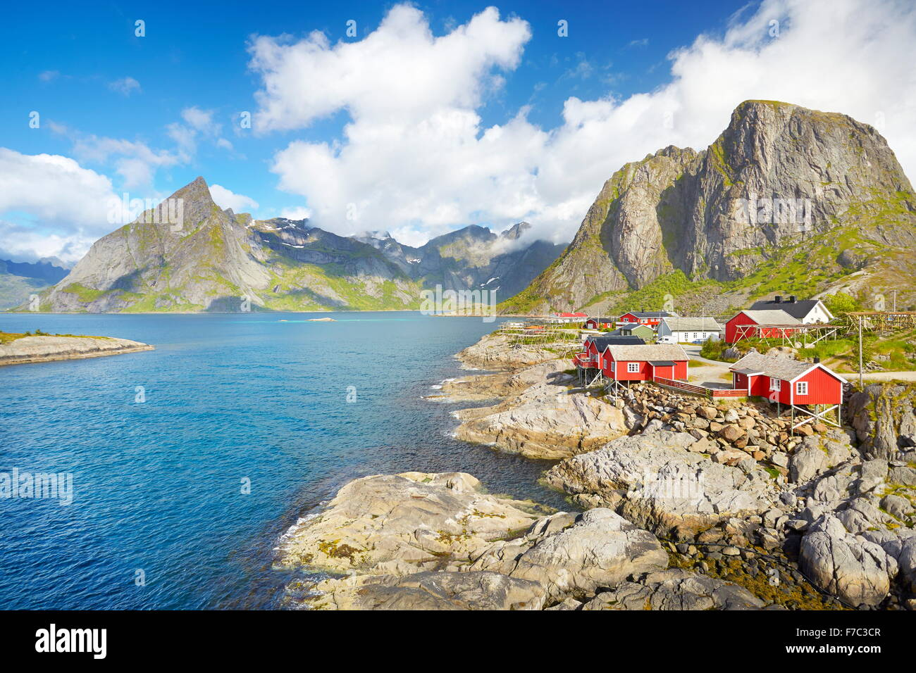Traditional red wooden fishermen`s huts rorbu, Lofoten Island landscape, Norway - Stock Image
