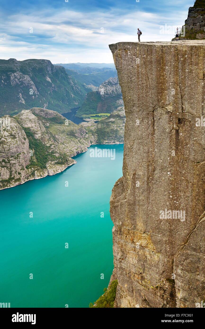 Landscape with single tourist on the Pulpit Rock, Preikestolen, Lysefjorden, Norway - Stock Image