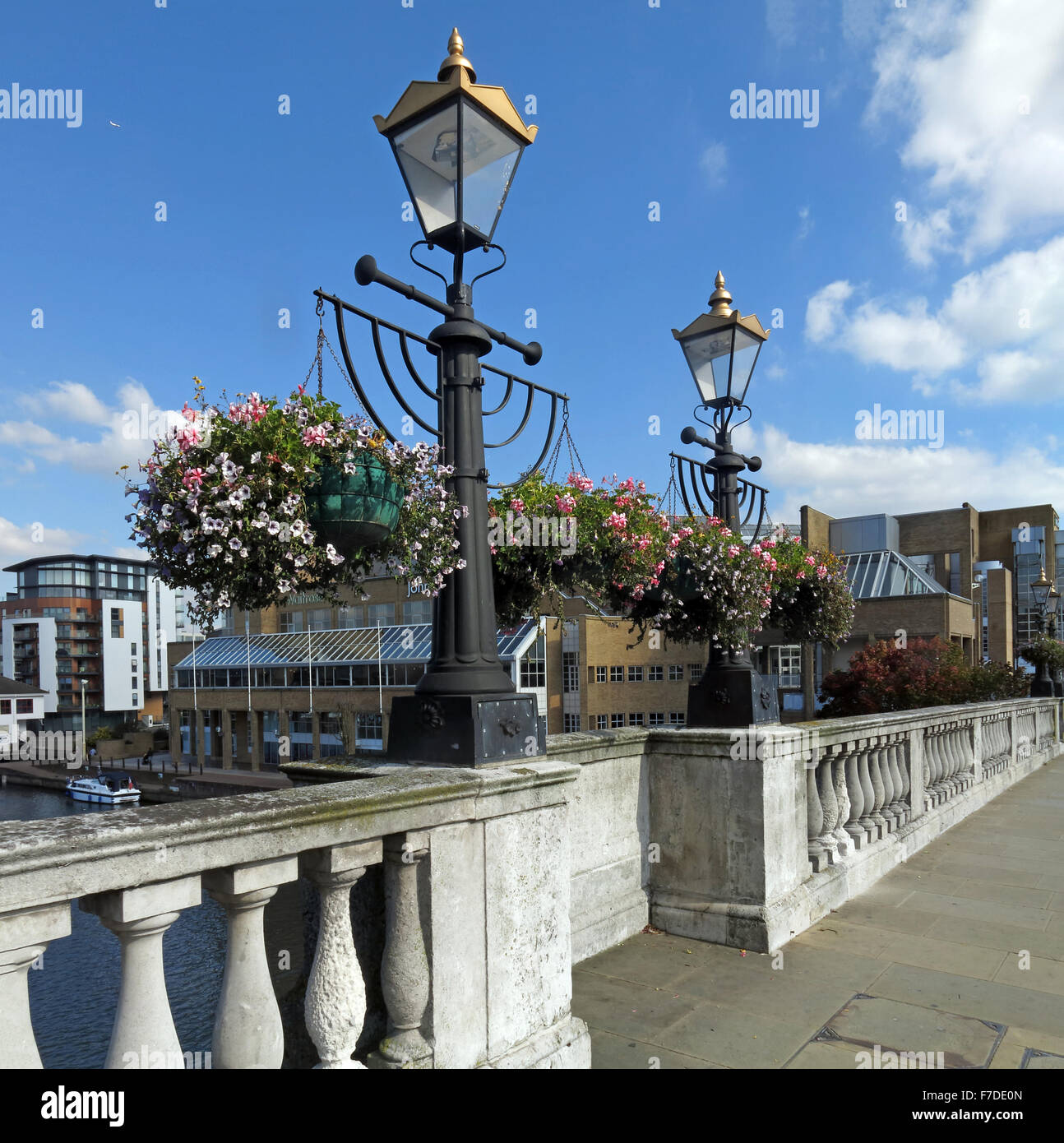Kingston,Bridge,river,rivers,England,GB,UK,KT1,great,britain,United,Kingdom,Victoria,lamp,post,summer,flowers,stone,work,upon,on,Hampton,Wick,A308,Royal,Borough,River Thames,lamp post,stone work,Kingston upon Thames,Kingston on Thames,KingstonUponThames,Hampton Wick,Royal Borough,GoTonySmith,town,path,crossing,link,between,medieval,market,town,1825,city,of,corporation,Portland,riverside,Surrey,architectural,architecture,tourism,tourist,tourists,path,walkway,SW,South,West,Buy Pictures of,Buy Images Of,Thames path,Thames Down Link,City of London Corporation,Navigation Committee,classical style,Portland Stone,Thames Riverside,South West