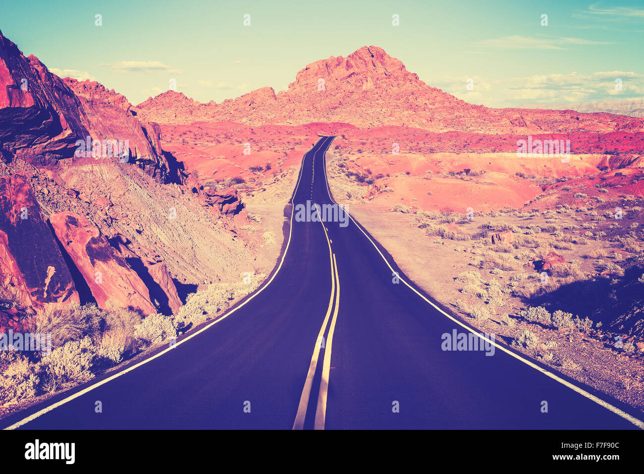 Vintage toned curved desert highway, travel concept, USA. - Stock Image