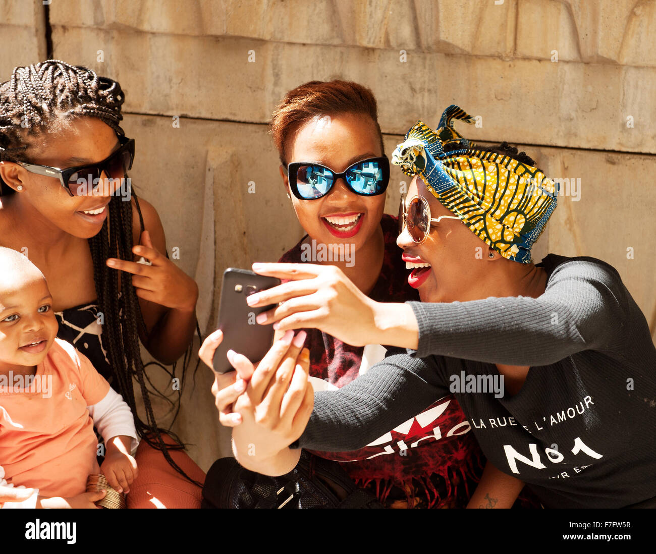 Stylish women hang out at the Neighbourgoods Market in  the Braamfontein neighbourhood of downtown Johannesburg, - Stock Image