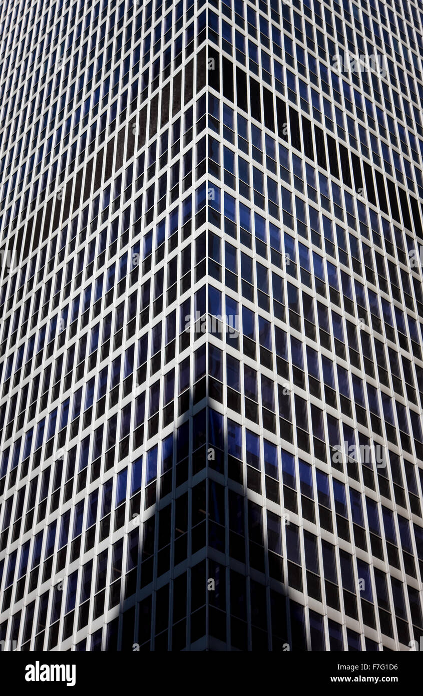 Detailed and abstract view of a modern building in Midtown Manhattan, New York City. Building shadow on high-rise - Stock Image
