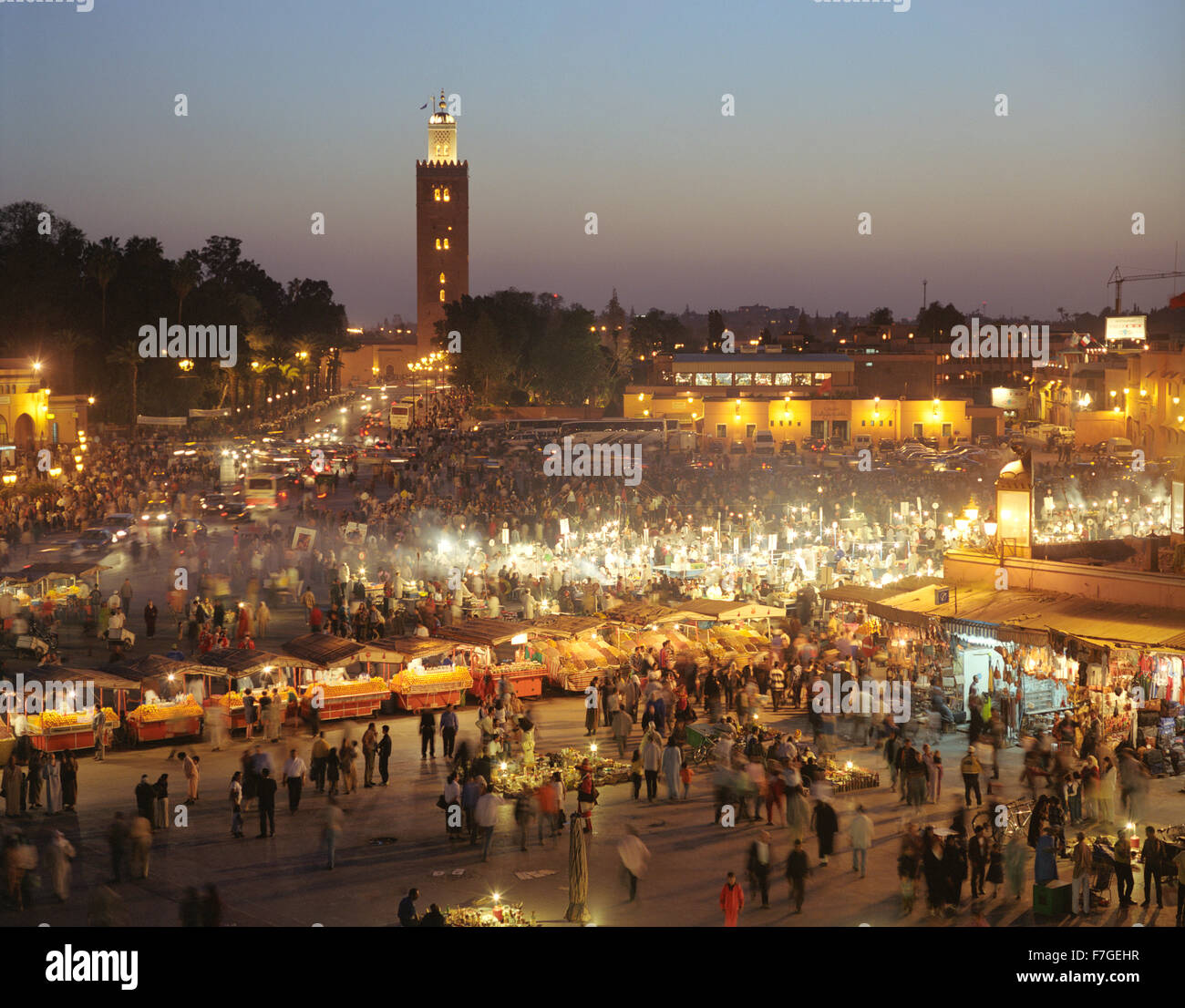 A view of food stalls in the marketplace and public square Place Jema al Fna in Marrakech at dusk. Marrakech, Morocco - Stock Image