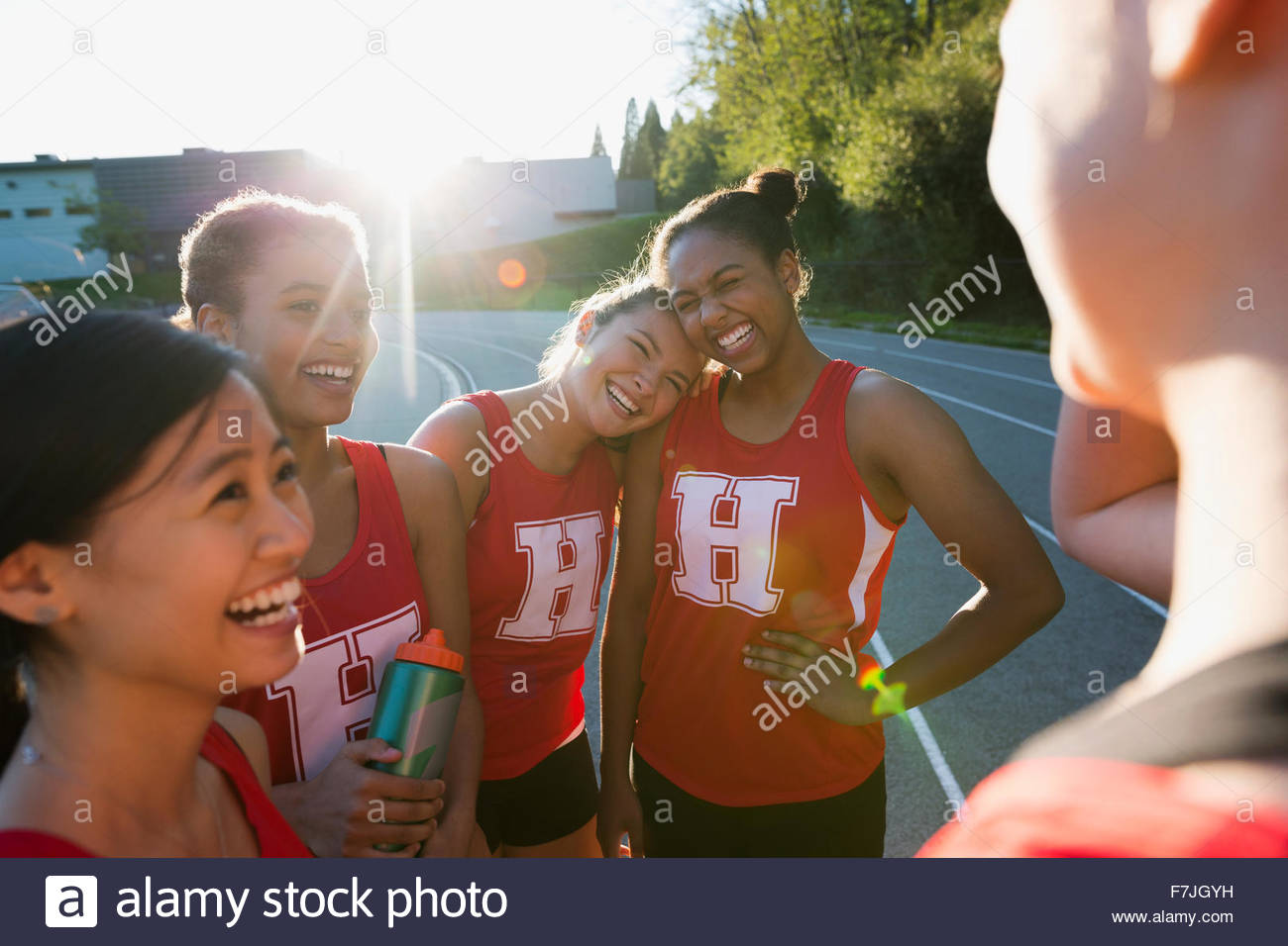 Female high school track and field team bonding - Stock Image