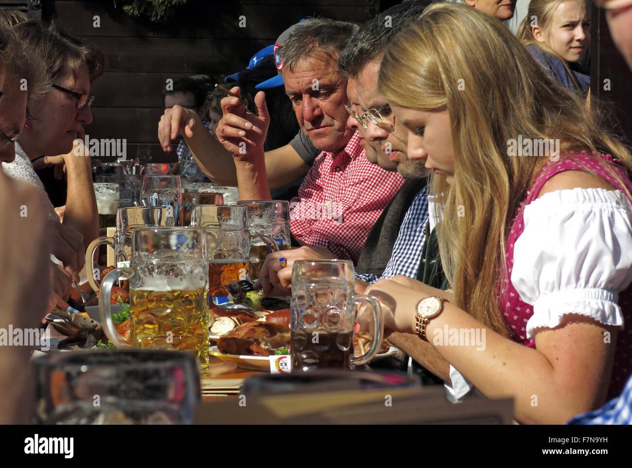 October,Autumn,tourist,tourists,in,Munchen,bier,Garten,bright,sunny,happy,tree,trees,table,tables,fun,enjoyment,tourism,ticket,tickets,Ammer,traditional,tradition,Beer garden,Munich Octoberfest,Munich Oktoberfest,GoTonySmith,Munich,Oktoberfest,in,Germany,Volksfest,beer,festival,and,travelling,funfair,Bavaria,event,Wiesn,fairgrounds,Octoberfest,October,Autumn,Theresienwiese,field,or,meadow,of,Therese,centre,beer,center,bier,roast,pork,chicken,building,buildings,Brezen,pretzels,Knödel,potato,bread,dumplings,Käsespätzle,Reiberdatschi,pancake,Sauerkraut,or,Rotkohl,Blaukraut,ale,Dirndl,Lederhosen,Sennerhut,tent,Buy Pictures of,Buy Images Of,Unity Day,Oktoberfest beer,Beer festival