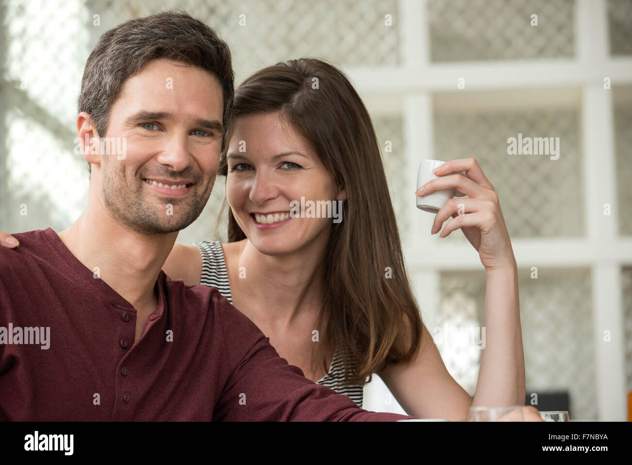Couple at cafe, portrait - Stock Image
