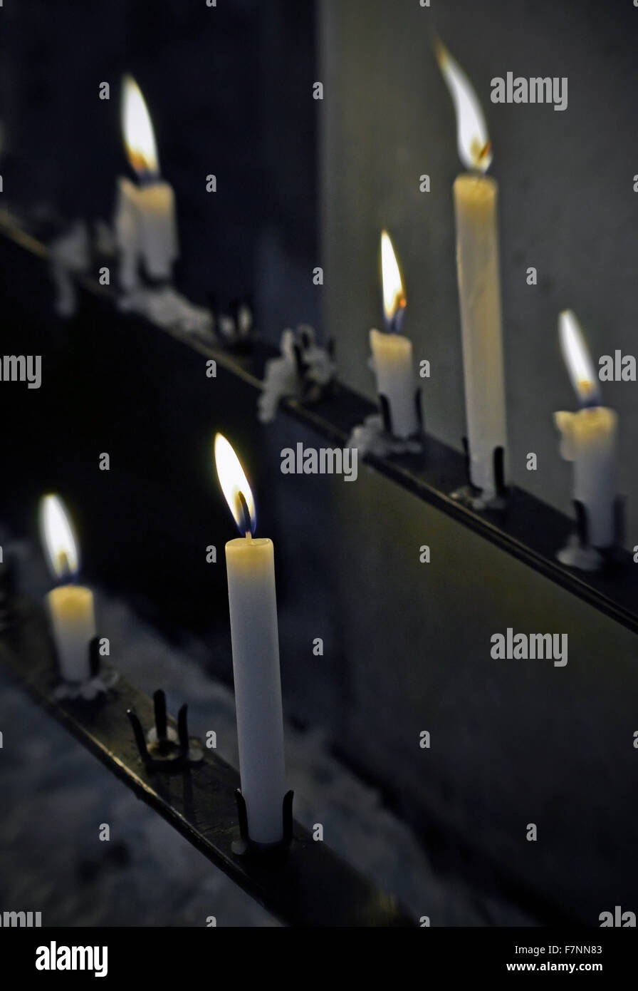 church candles burning - Stock Image