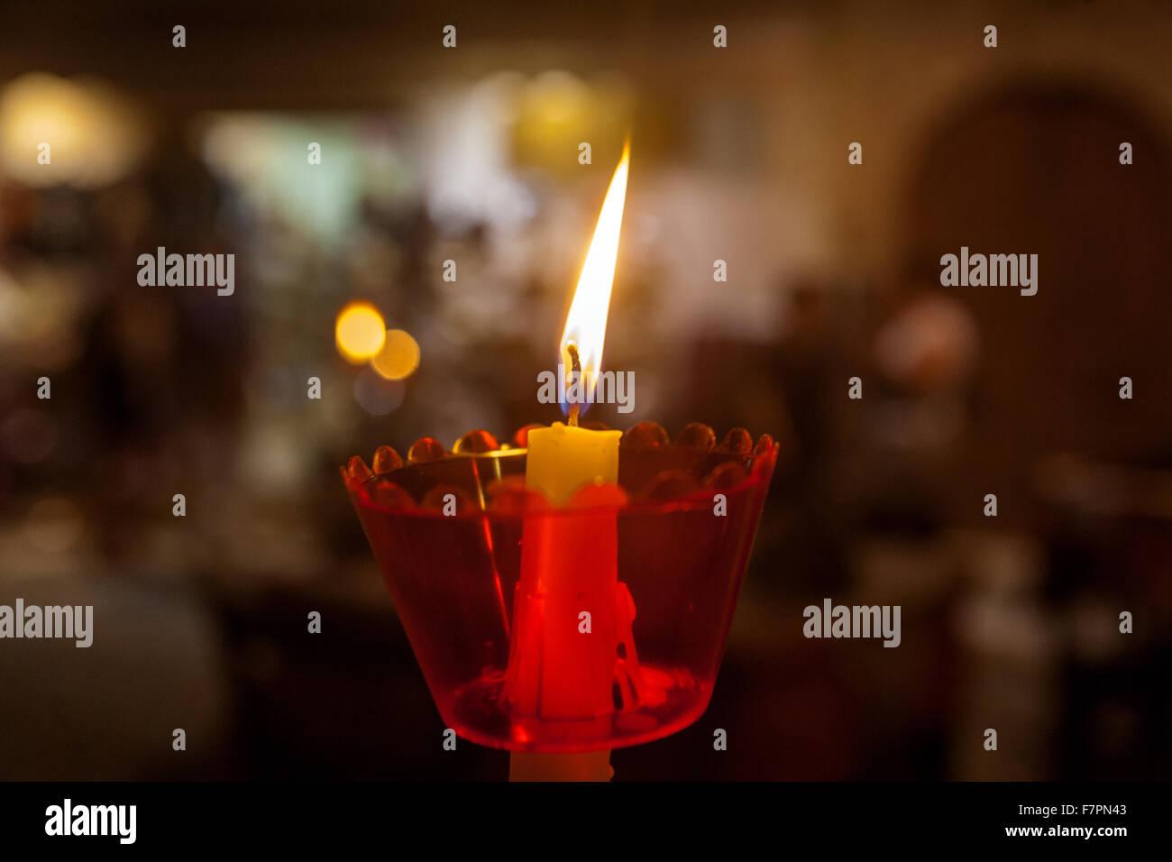 Closeup of a burning candle - Stock Image