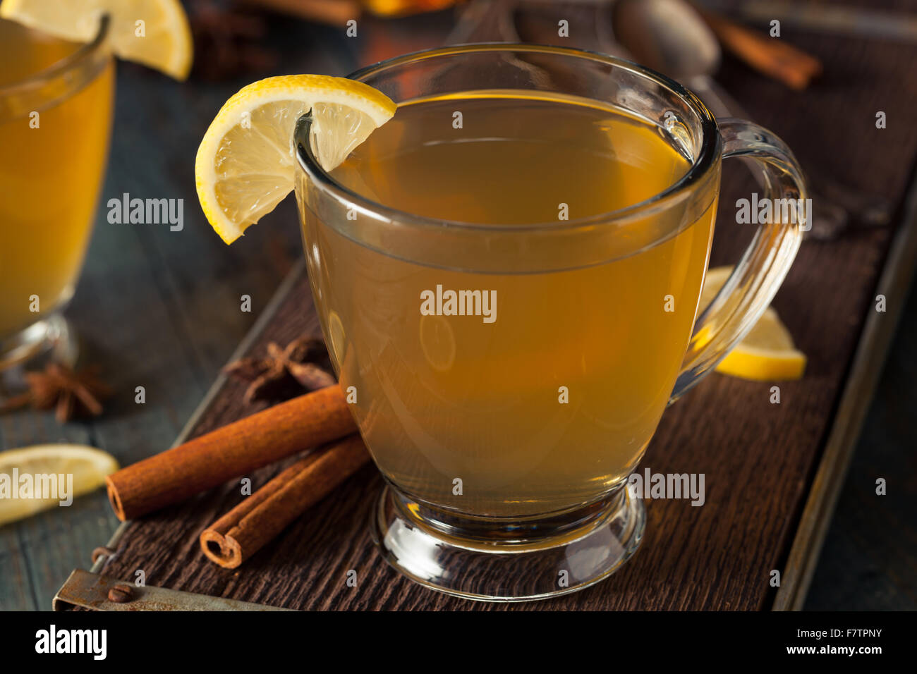 Warm Hot Toddy with Lemon Bourbon and Spices - Stock Image