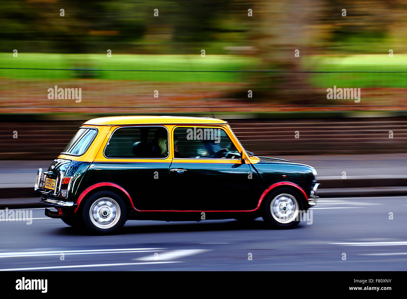 Original Mini travelling through Kensington, London, UK - Stock Image