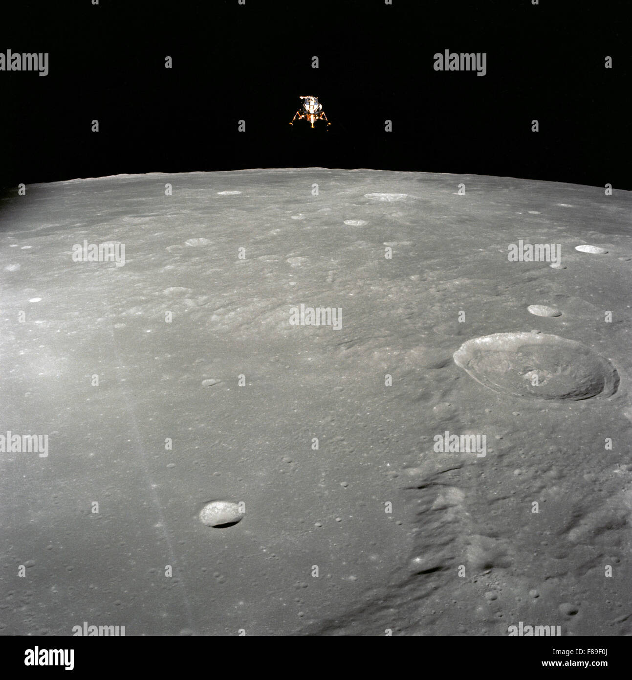 Apollo 12 Lunar Module (LM), in a lunar landing configuration, is photographed in lunar orbit from the Command and - Stock Image