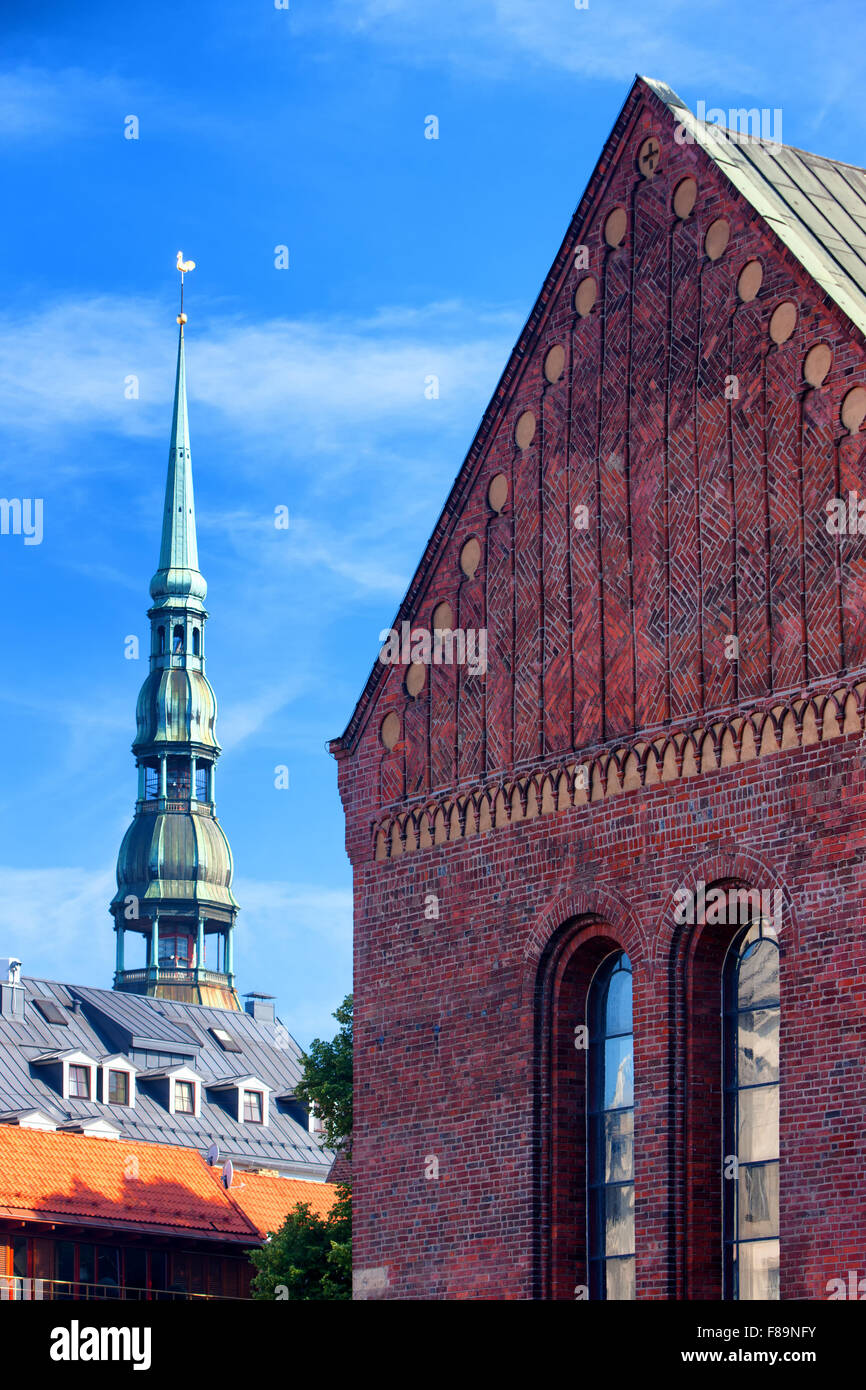 Facade of the Cathedral Church of St. Peter and against the blue sky in Riga in the summer on a sunny day - Stock Image