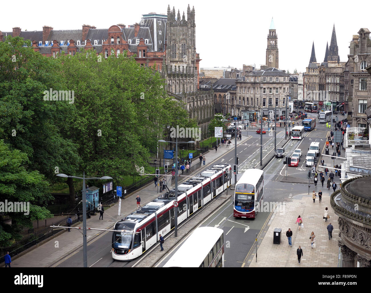 Westend,street,city,centre,Lothian,buses,tram,bus,street,2015,Edinburgh,Scotland,UK,airport,capital,above,architecture,tourist,tourism,attraction,british,people,pedestrians,road,scene,Princes St,Princes Street,city centre,West End,Airport Tram,british culture,GoTonySmith,elevated view,europe,european,heritage,shopping,shops,automobile,coach,double,decker,Buy Pictures of,Buy Images Of,european culture,Shopping Street