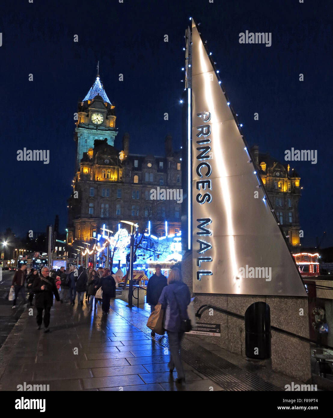 GB,Great,Britain,Night,time,nighttime,dusk,slide,hotel,Balmoral,Hotel,Clock,street,Mall,Princes Mall,Shopping,Xmas,Festive,Hogmanay,tourist,travel,lit,low,light,Helter,Skelter,winter,fun,entertainment,Scottish,Scotland,UK,Lothian,Lothians,Midlothian,New Year,Low light,Helter Skelter,GoTonySmith,pavement,walkway,walk,way,reflection,blue,Buy Pictures of,Buy Images Of,Princes Mall