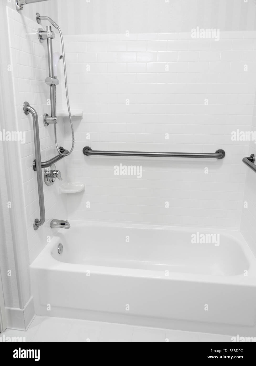 Handicapped disabled access bathroom bathtub shower with grab bars ...
