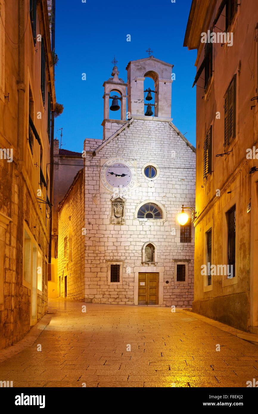 Sibenik, Croatia - Old town street with the Church of Saint Barbara - Stock Image