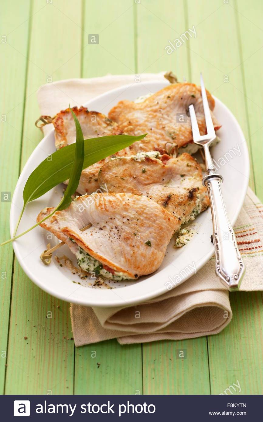 Chicken escalopes stuffed with ramsons (wild garlic) cream - Stock Image