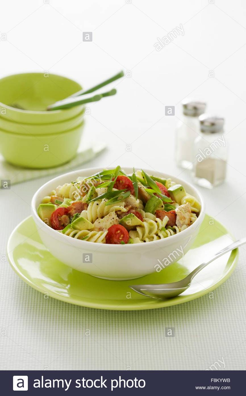 Pasta salad with avocado and chicken - Stock Image