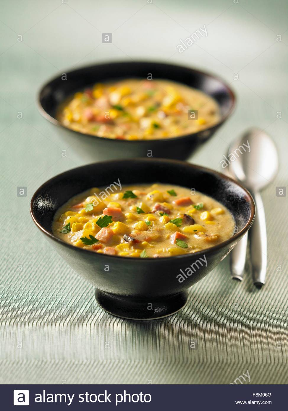 Two bowls of corn chowder - Stock Image