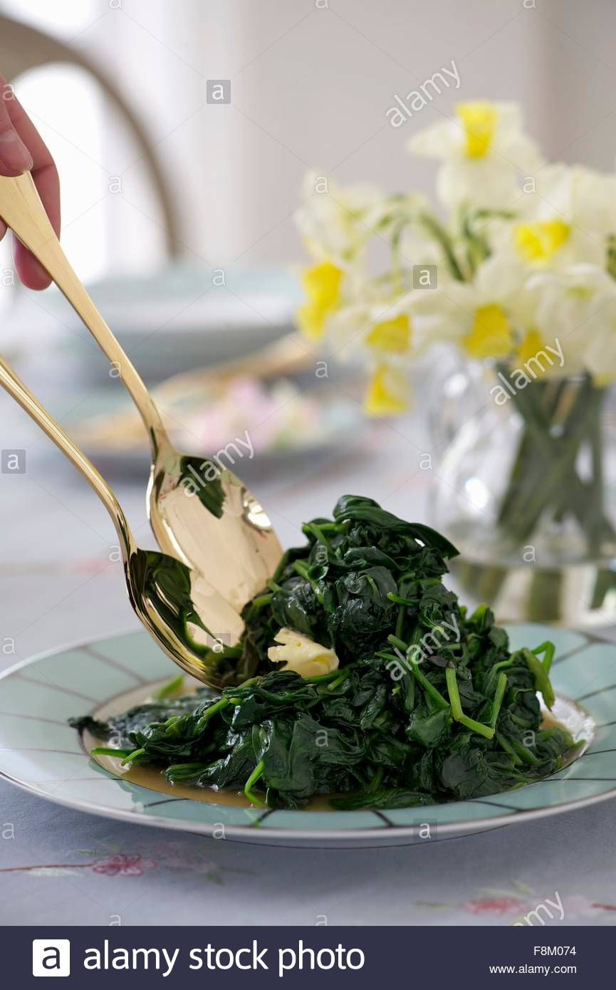 Spinach with butter for Easter - Stock Image