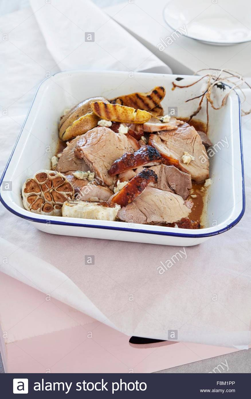 Roast pork with curried pears and blue cheese - Stock Image