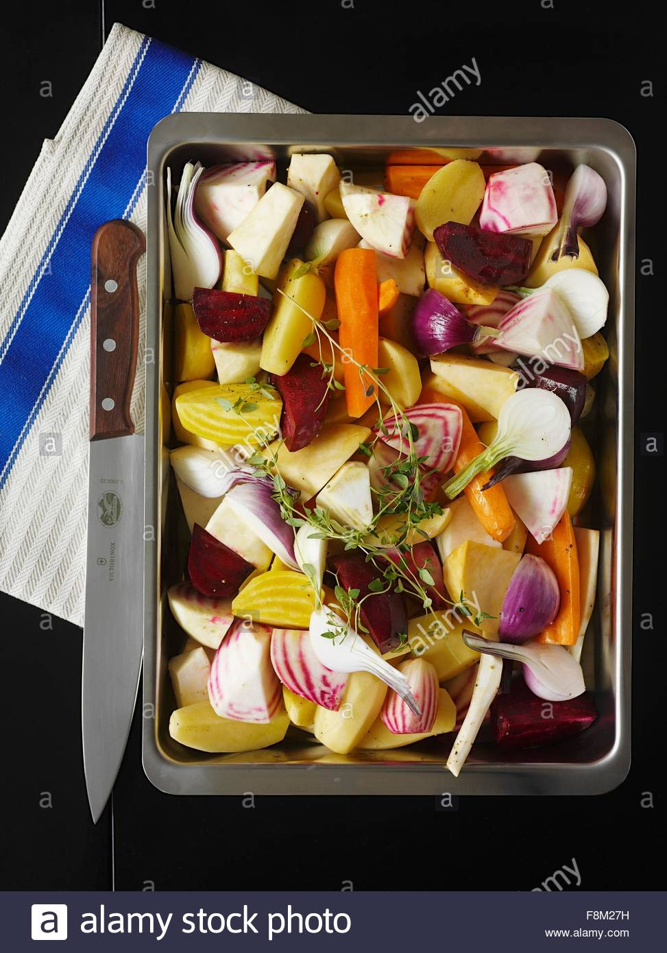 Root vegetables on a baking tray (raw) - Stock Image