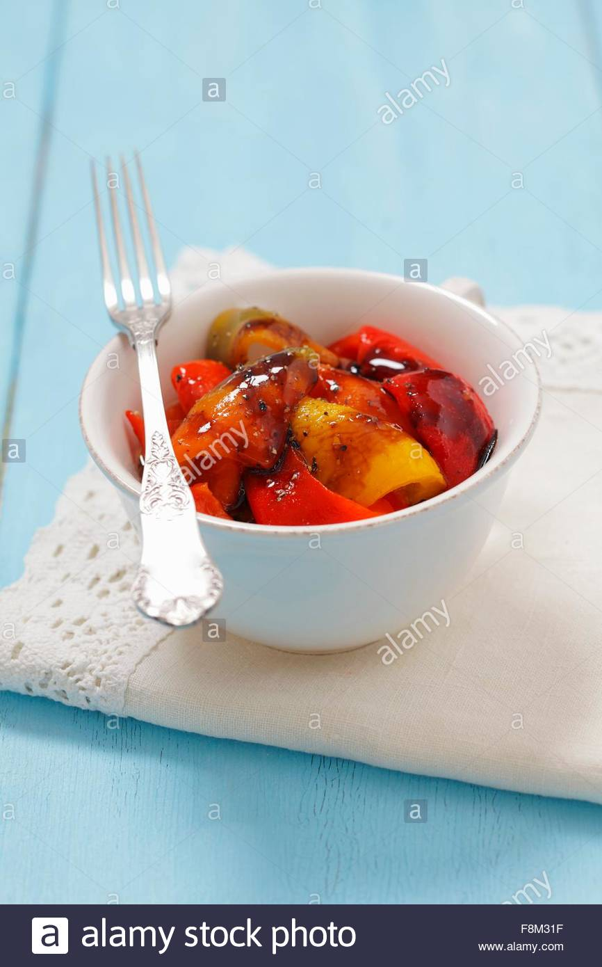 Roasted peppers in a bowl - Stock Image
