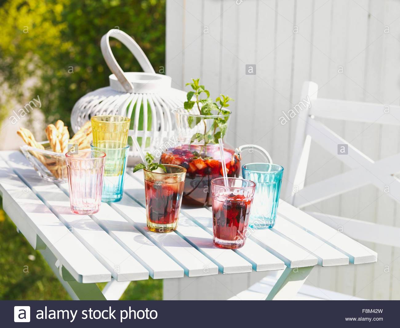 Sangria on a summery garden table - Stock Image